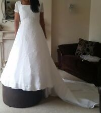 Stunning white wedding dress size 12 with sparkling embellishments.