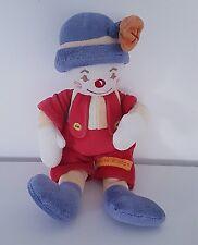 Doudou peluche clown hochet salopette rouge chapeau bleu
