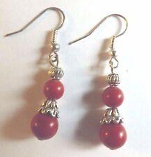 Boucles d'oreilles argentées perles rouges foncés