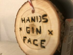 Hand burnt small wooden hands gin face sign