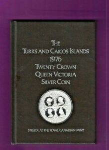 1976 TURKS & CAICOS 20 CROWN SILVER PROOF COIN IN BOOK 39 GRMS STERLING SILVER