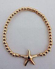 Starfish bracelet gold tone base metal stretch small beads 7.25 inch fresh