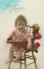 Lovely vintage baby chair roses girl new year greetings tinted early postcard