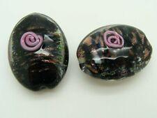 1 perle ovale 28mm verre lampwork noir et motifs roses et dorés DIY bijoux