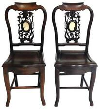 Two Chinese style side chairs, 20th C., carved and pierced splats with. Lot 85