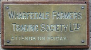 Old brass English plaque sign Wharfedale Farmers Trading Society Otley Yorkshire