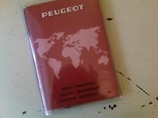 Complete owners handbook/service book/dealer list for a  peugeot  504 1975?