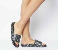 Sandali e scarpe nere GUESS per il mare da donna