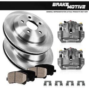 Rear Brake Calipers & Rotors + Ceramic Pads For 2011 2012 2013 - 2016 Scion TC