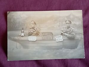 VINTAGE WW 1 ERA REAL PHOTO POSTCARD,TWO YOUNG SOLDIERS IN FAUX BOAT