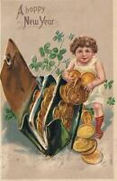 1910 VINTAGE EMBOSSED GERMAN GIRL CHILD & LUCKY WALLET PURSE FULL COINS POSTCARD