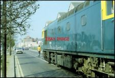 PHOTO  WEYMOUTH CLASS 33 DIESEL THREADS ITS WAY THROUGH THE STREETS OF WEYMOUTH