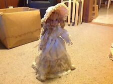 "Baby Doll with Porcelain ? Face, feet and hands.     17""  long.  Used.  With Sta"