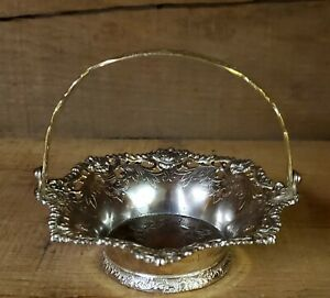 Vintage Silverplated Trinket Dish With Piercings and Ornate Brass Handle. Used