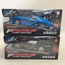 Two Boxed Radio Control Muscle Racing Cars