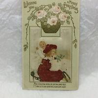 Vintage Postcard 1915 Christmas Girls on Sled Scene Greeting Embossed