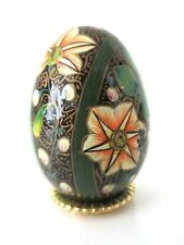Cloisonne style egg hand painted black with white and gold floral design stand