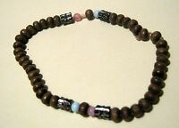 Pretty dainty lightweight wooden beaded elasticated bracelet with feature beads