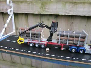 1.50 Rare WSI Code 3  Tri Axle Loaded logging trailer with Tekno Crane