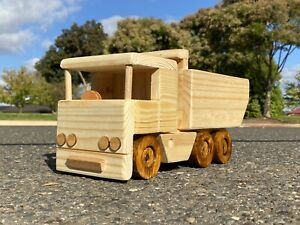 Handmade wooden toy Dump Truck in natural timber.