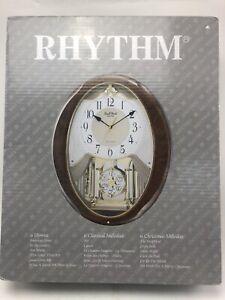 RHYTHM MUSICAL WALL CLOCK 10851