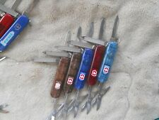 Lot of 5 Victorinox, SignatureLite Swiss Army knives in translucent colors