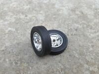 Strombecker #8314 chrome mag spoke wheels and #8442 Cheater Slick tires. 1 pair.