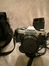 Canon AE-1 35mm SLR Camera with 50mm f/1.8 Lens And Extras