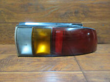 Geo Storm Hatchback  /  1990  1991  1992  1993  /  Right Passenger Tail Light