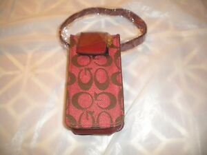 NEW RED  CELL PHONE POUCH WITH DESIGN  AND  A   STRAP FOR THE PURSE