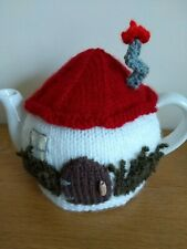 Hand-knitted Toadstool House tea cosy. Medium size