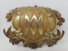 plaque décoration de bronze au monogramme