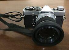 OLYMPUS OM1 AND ZUKIO 50MM F1.4 LENS filter & lens hood