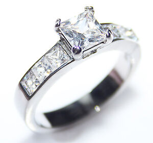 BLOW OUT SALE! Women's Stunning Stainless Steel Princess Cut LAB Diamond Ring.