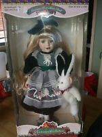 Victorian dress porcelain doll with toy rabbit.