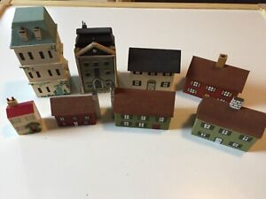 collection of vintage wooden miniature dolls houses