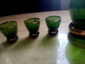 Green Glass decanter and small glasses.  Ref 3