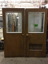 Pair of Metal Architectural Salvage Doors with Chicken Wire Glass