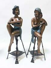 bronze lady holding champagne cup on stool statues