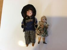 Antique All Bisque Doll And A Bisque Head Doll