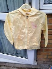 GIRLS RAIN JACKET FROM NEXT THAT FOLDS INTO A LITTLE BACKPACK WITH A CAT ON IT +