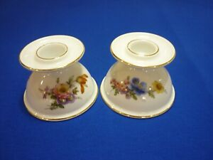2 , porcelain candle holders in white with a lovely floral pattern VGC