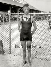 Handsome young man in swim suite, vintage photo, gay interest