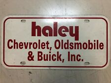 Haley Chevrolet Oldsmobile Buick, Inc Dealers Advertisement License Plate, Plast