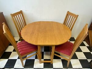 Modern oak drop leaf dining table with four matching oak dining chairs -Delivery