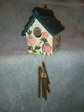 New listing Wind Chimes And Decorative Bird House. Never hung up. Approx.9.5 inches x 4 x 4