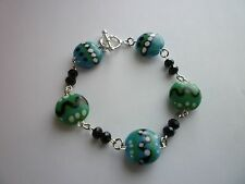 Silver Tone Charm Bracelet 8 inches Abstract Glass Beads Turquoise Toggle Clasp