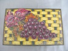 A 1950s Jacobs Biscuit Tin with raised grape design