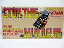 STOP THIEF Electronic Cops and Robbers Board Game BILINGUAL 99% complete