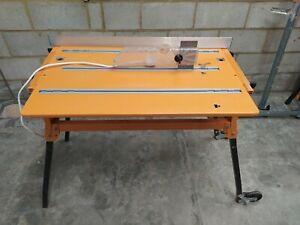 Triton 2000 Workcentre WCA201 with Sliding Rail and Blade Guard - Orange DIY